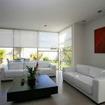 Interior screens in a modern white setting.
