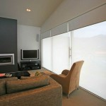 Wall of interior shades lets in mountain view and reduces glare.