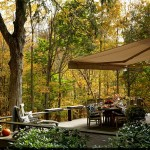 Retractable awning in a lovely wooded setting.