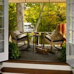 Entryway and outdoor seating shaded by a retractable awning.